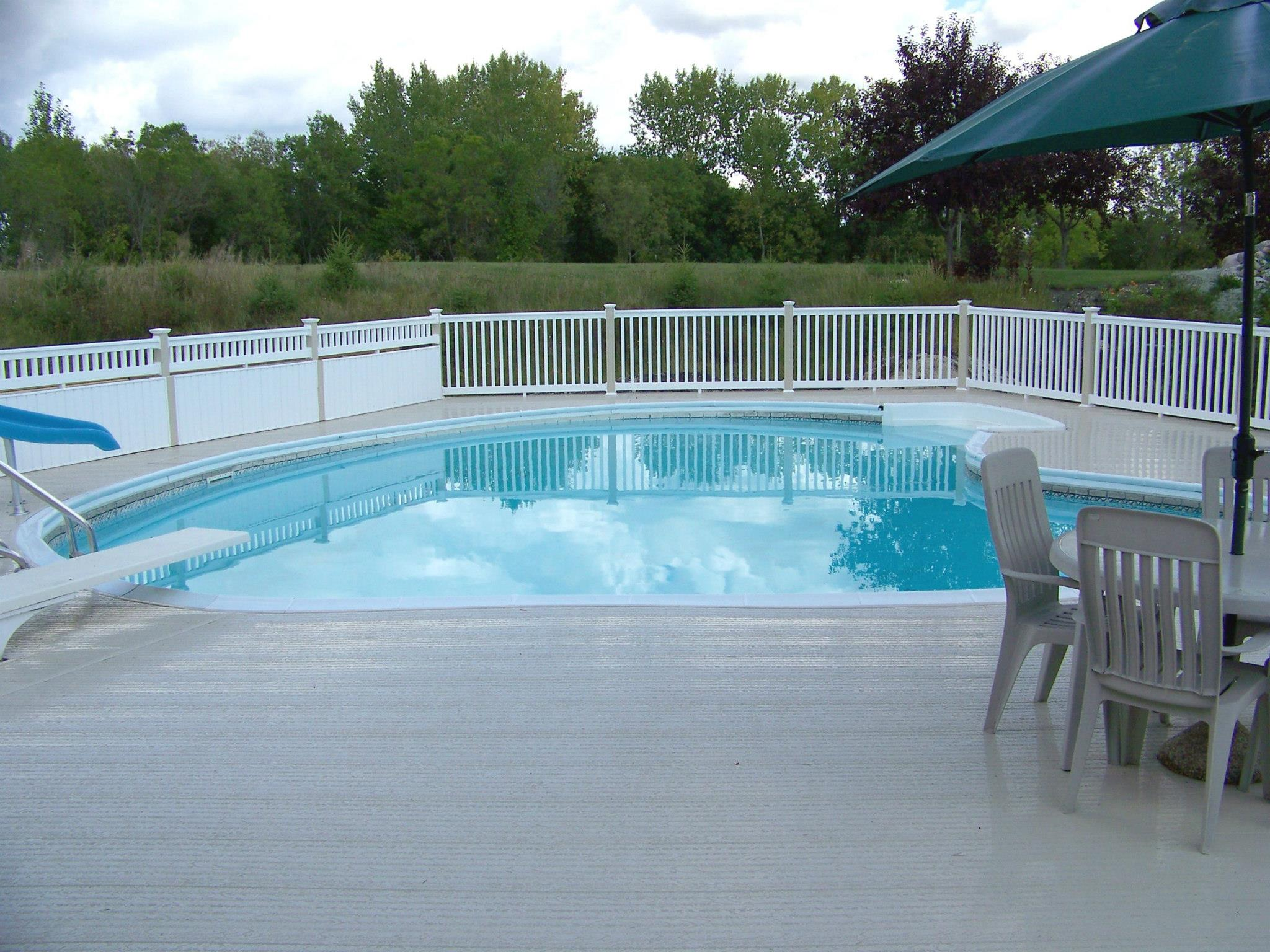 Pool with surrounding fence